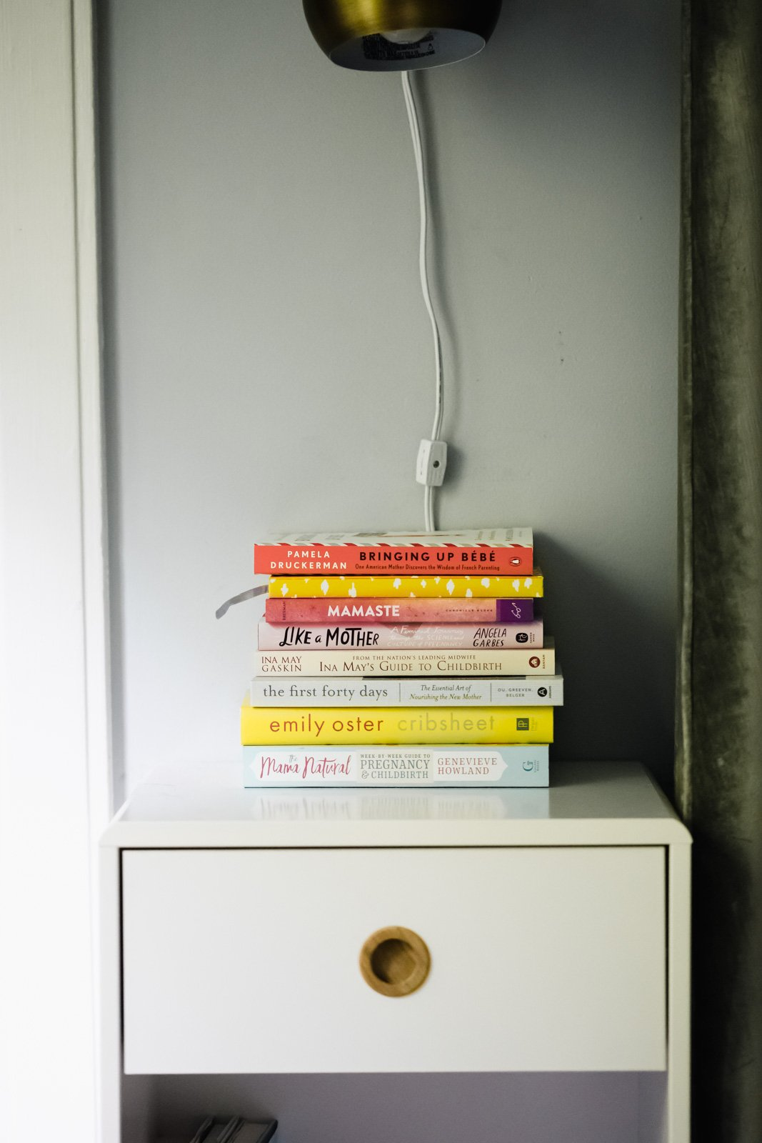 pregnancy books on a nightstand