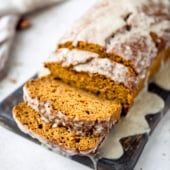 healthy pumpkin bread sliced on a wooden board