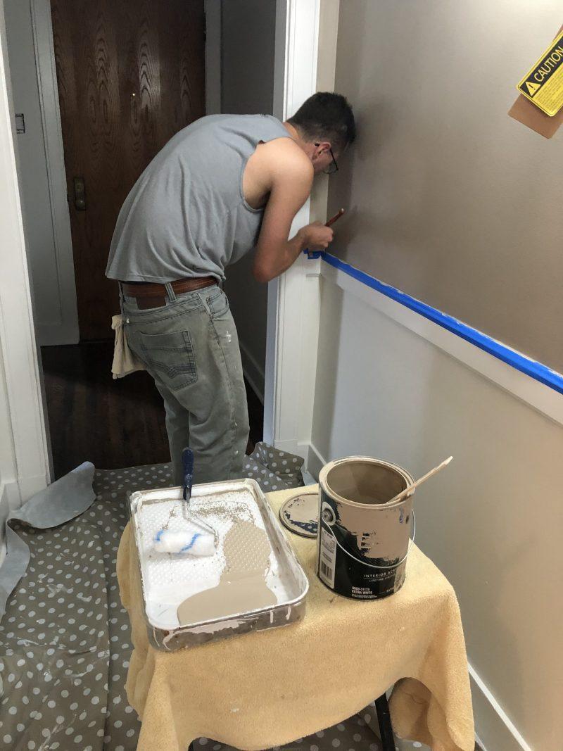 tony painting a hallway wall
