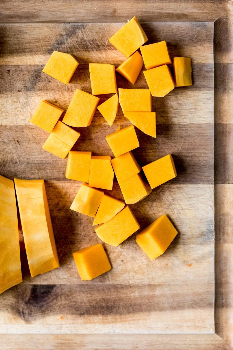 butternut squash cubes on a cutting board