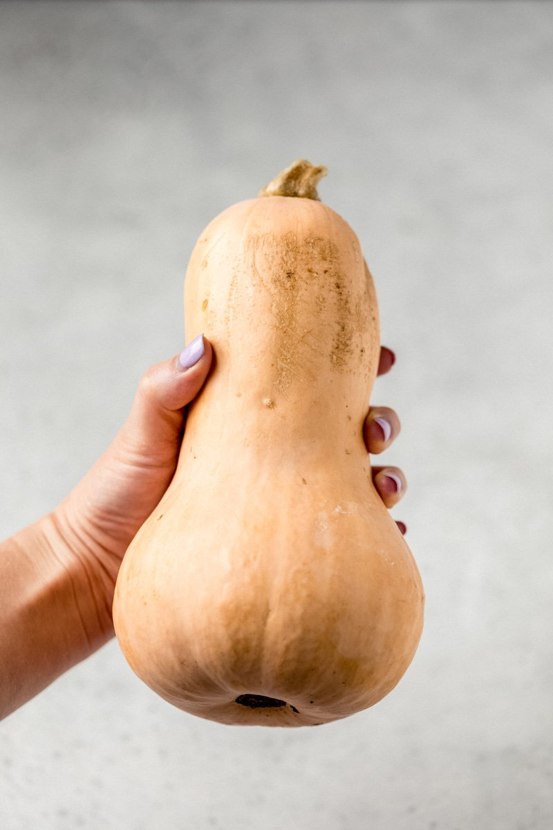 hand holding butternut squash