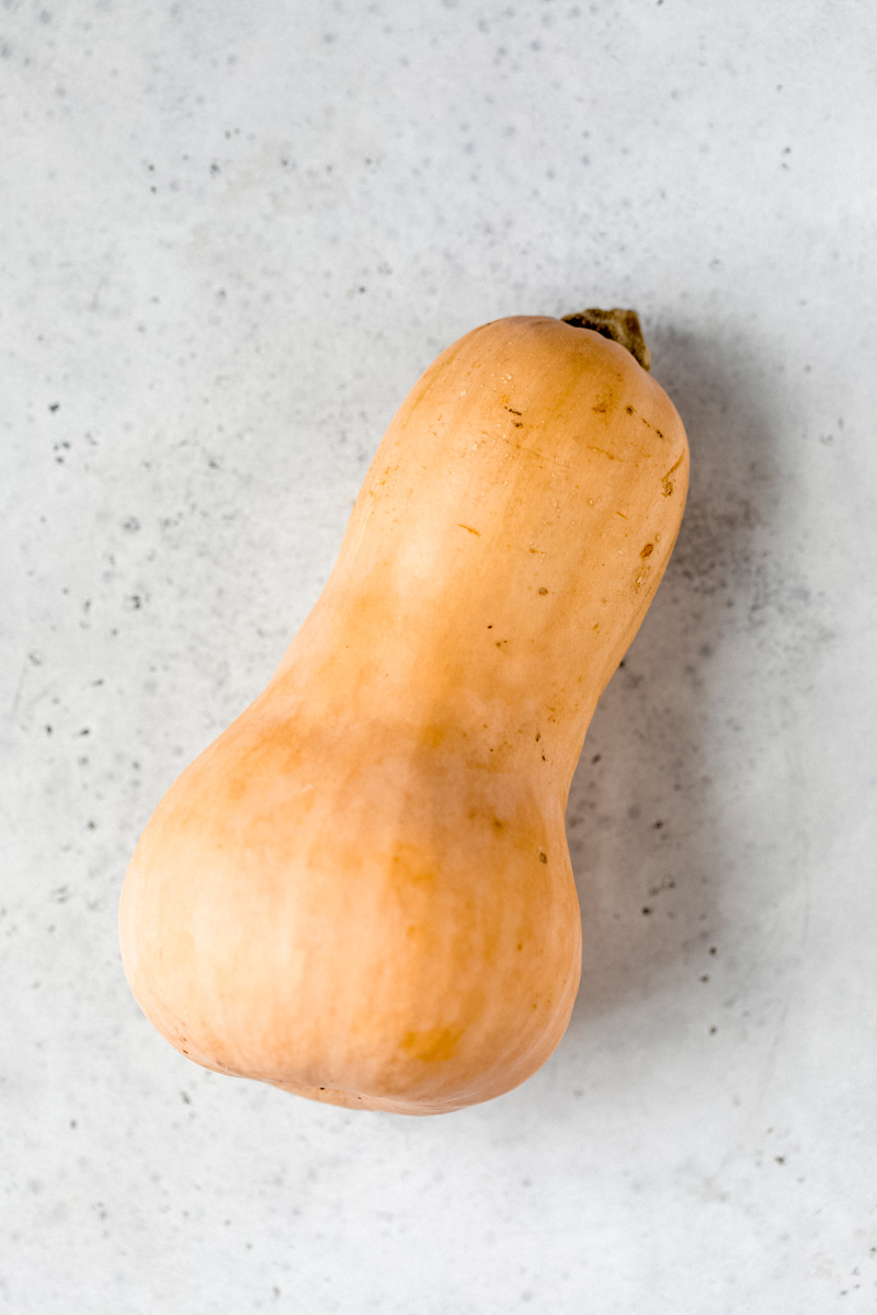 butternut squash on a gray surface