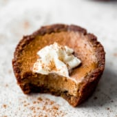 mini pumpkin pie with a bite taken out