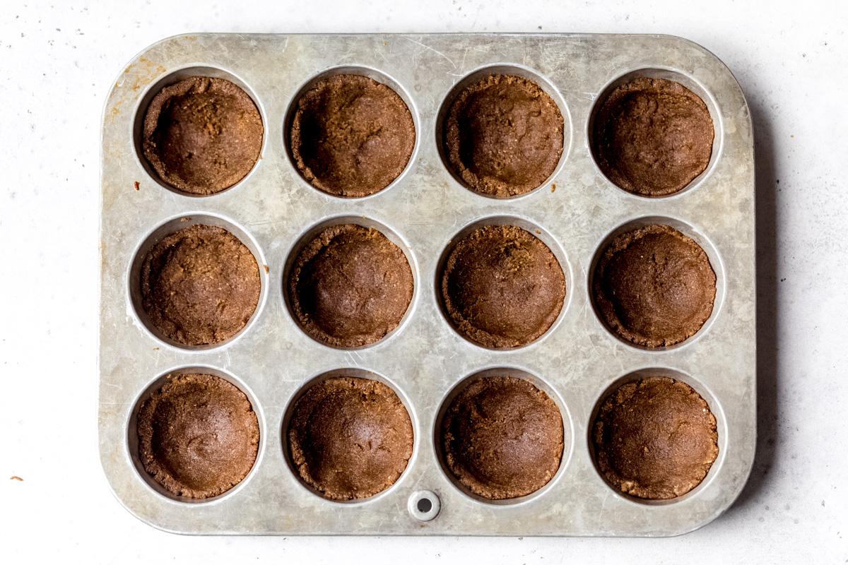 gingerbread cookie crust in muffin tin