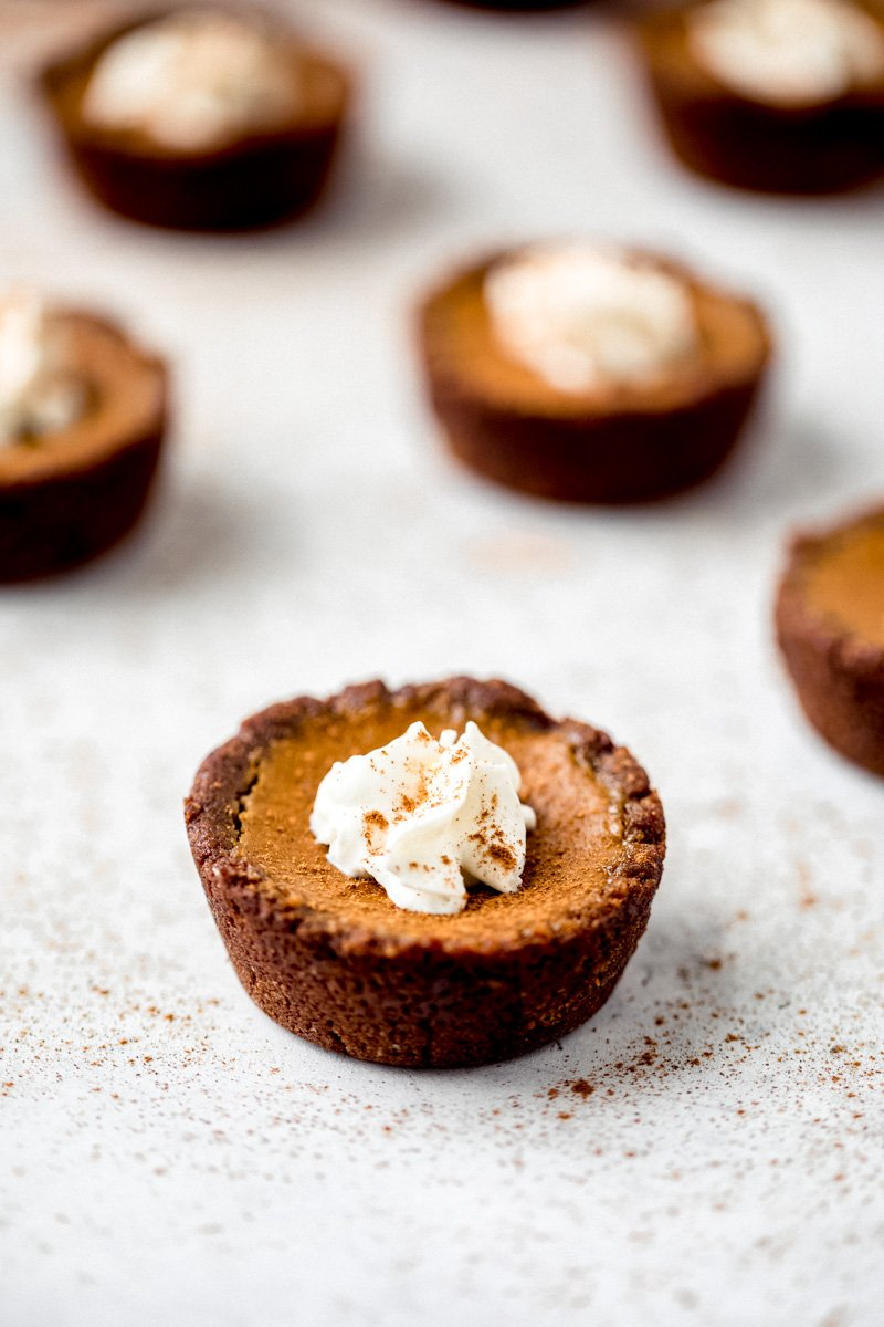healthy mini pumpkin pies with whipped cream