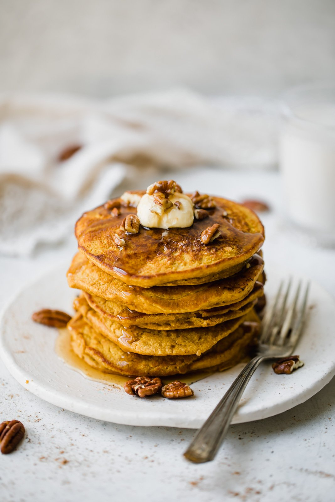 healthy pumpkin pancakes on a plate with a fork