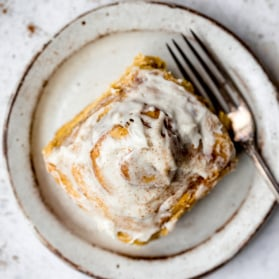 pumpkin cinnamon roll on a plate