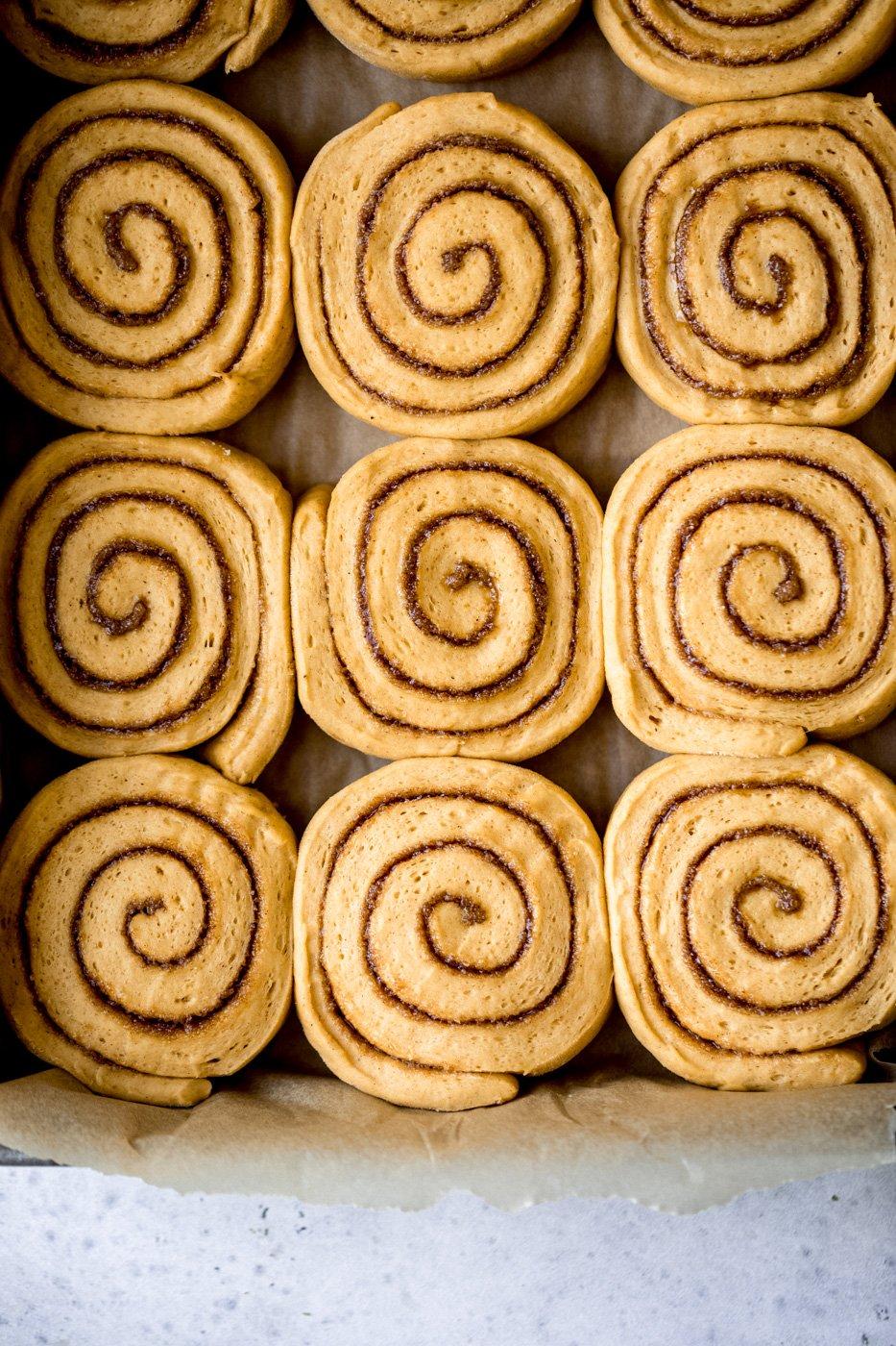 pumpkin cinnamon rolls in a pan before being baked