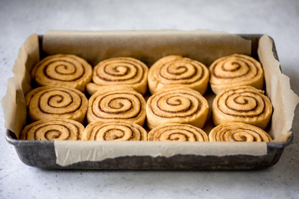 pumpkin cinnamon rolls in a pan before baking