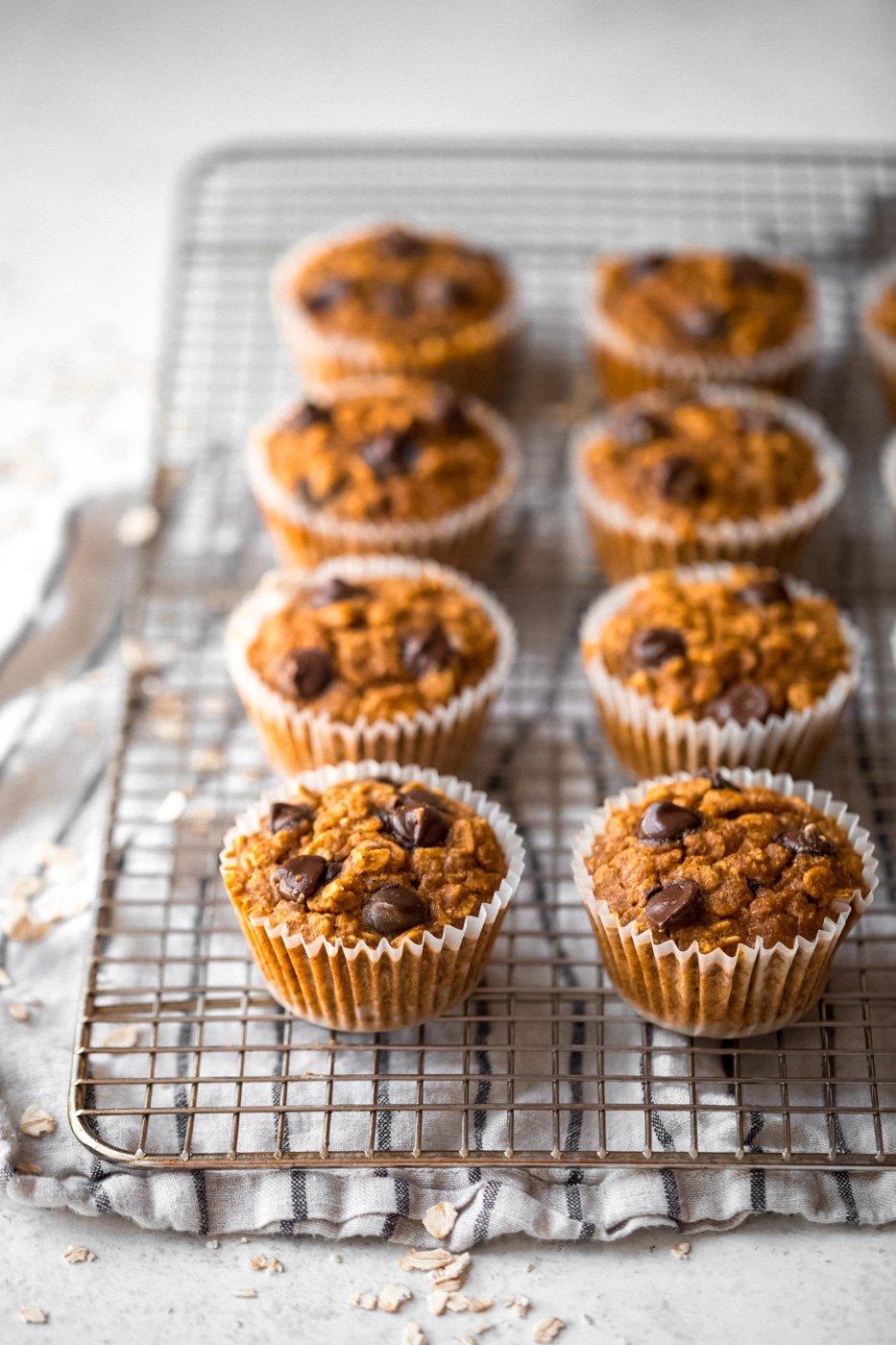 pumpkin oatmeal cups with chocolate chips on a cooling rack