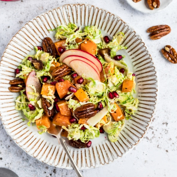 butternut squash brussels sprouts caesar salad on a plate