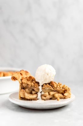 slice of dutch apple pie on a plate topped with ice cream