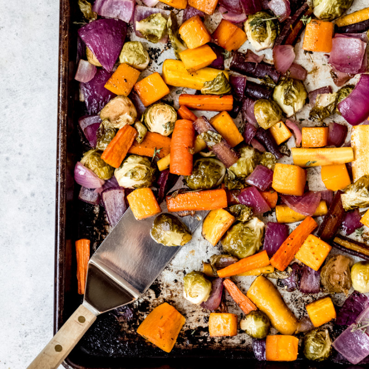 sheet pan roasted vegetables with a spatula