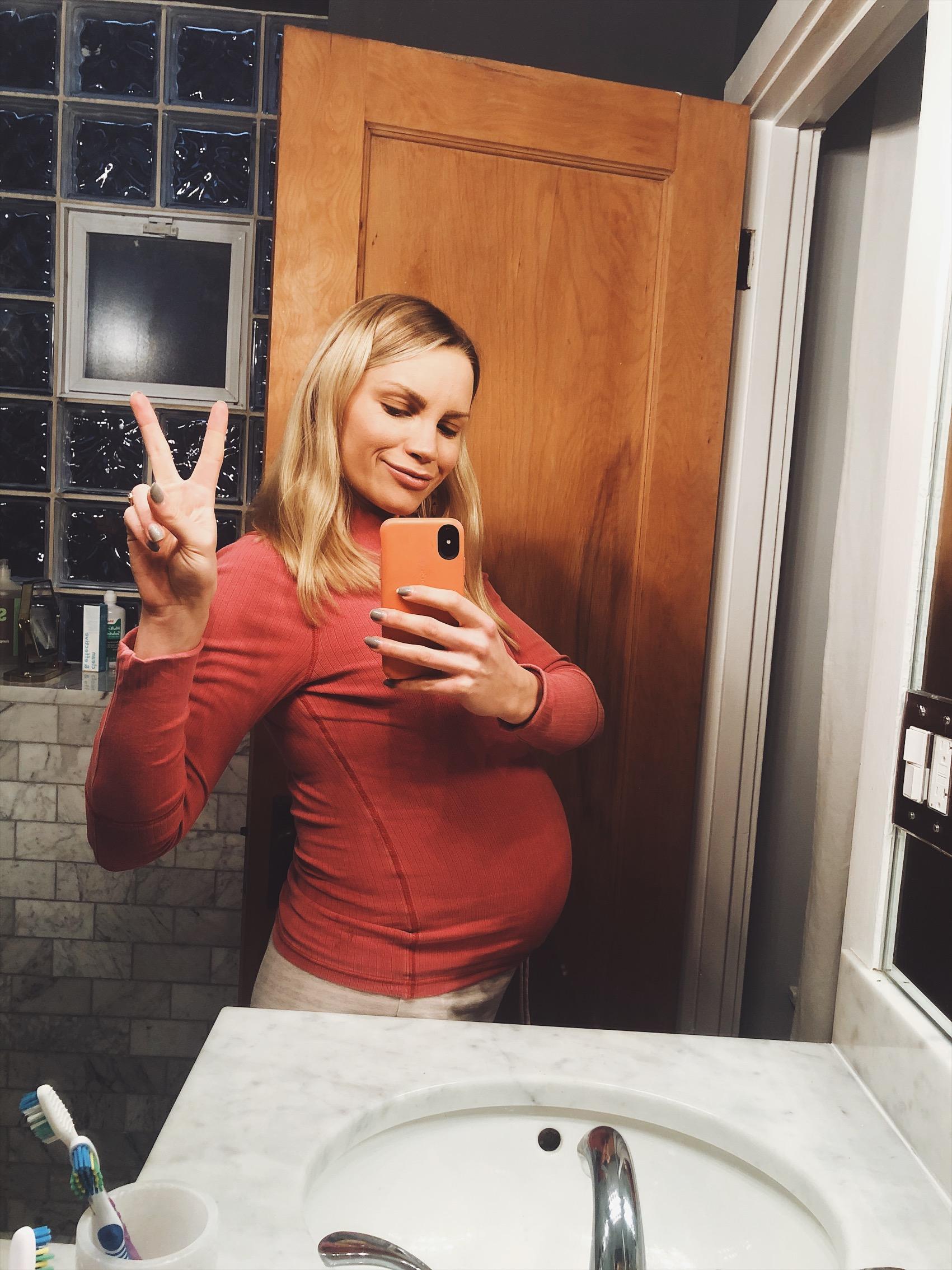 monique taking a bathroom mirror selfie