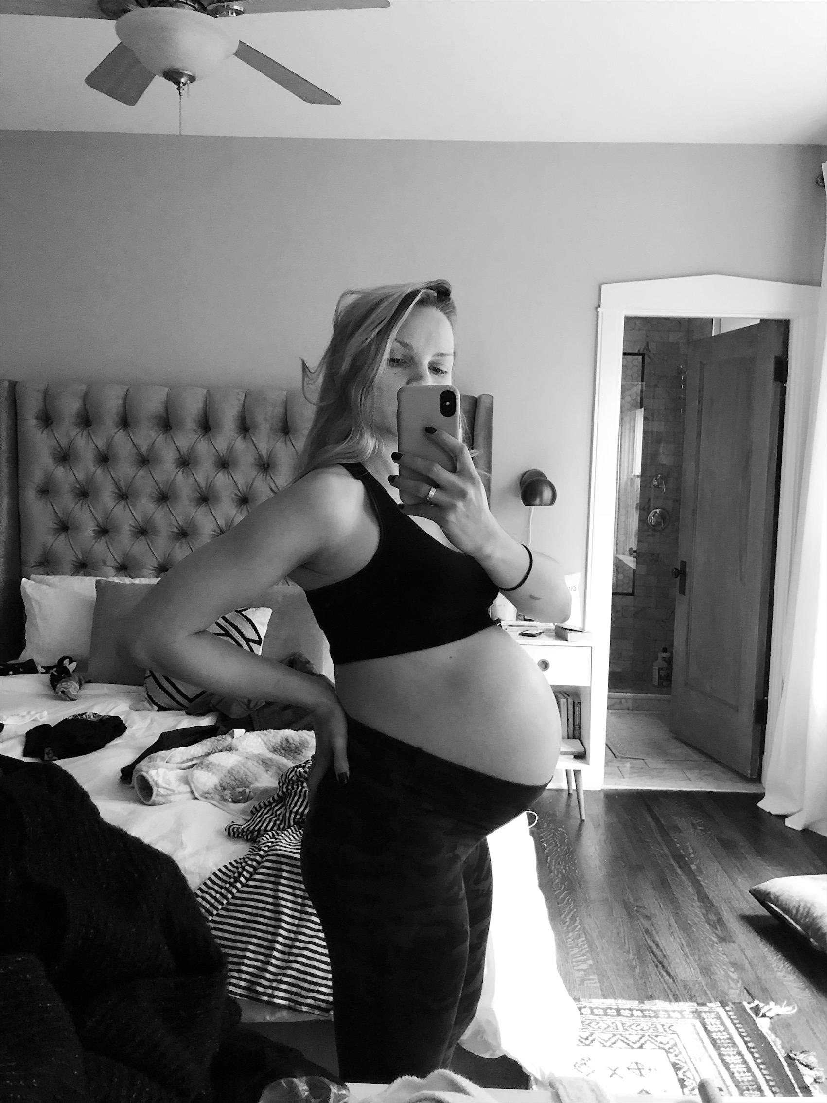 monique taking a pregnant mirror selfie