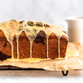 orange gingerbread loaf with orange icing on a wire rack