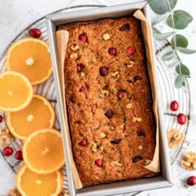 paleo cranberry orange bread on a cooling rack