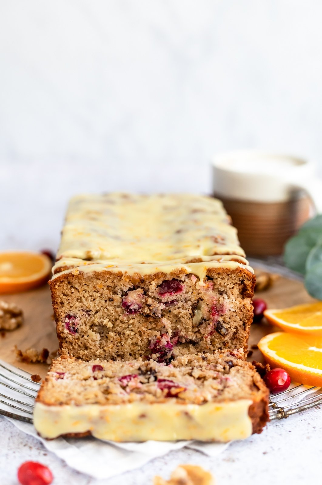 paleo cranberry orange bread with a slice cut out