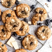 white chocolate blueberry coconut oatmeal cookies on a wire rack