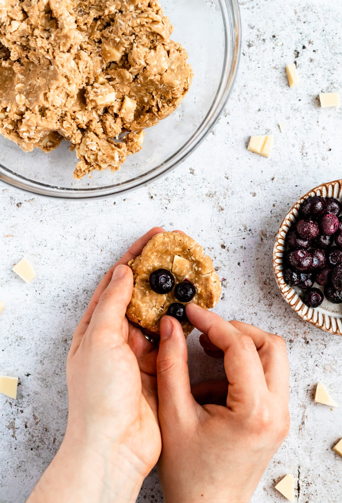 adding blueberries to coconut oatmeal cookie dough