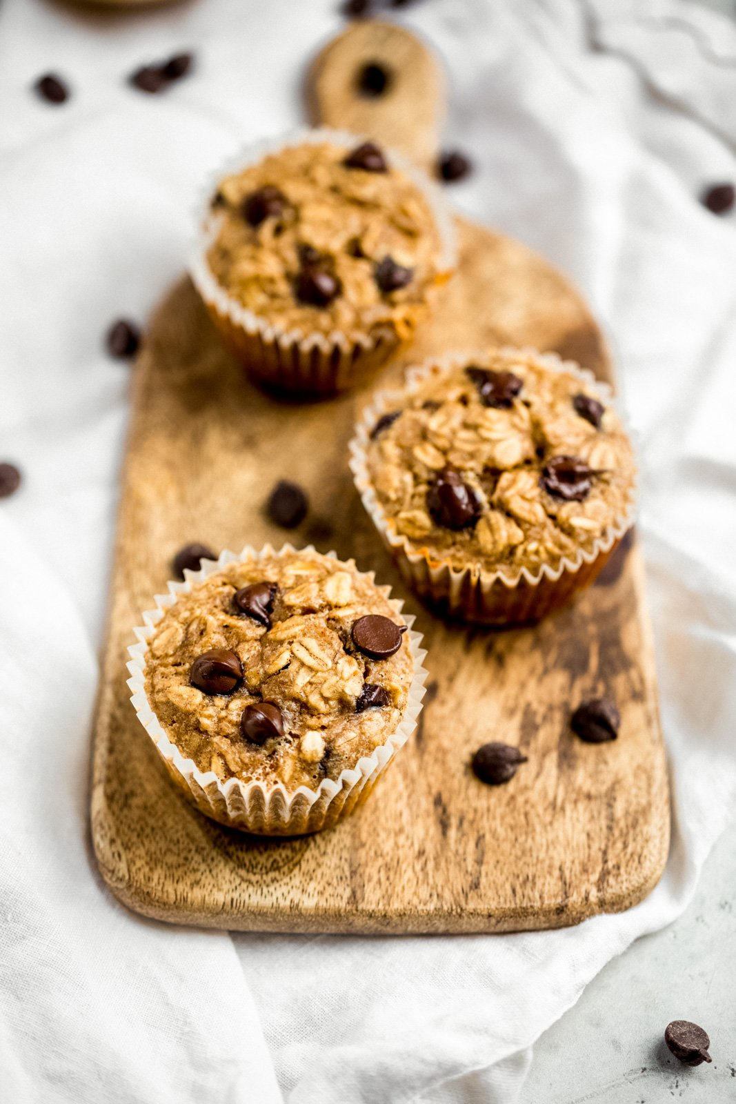 peanut butter banana baked oatmeal cups on a cutting board