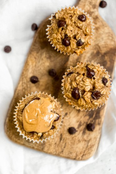 peanut butter banana baked oatmeal cups on a wooden serving board