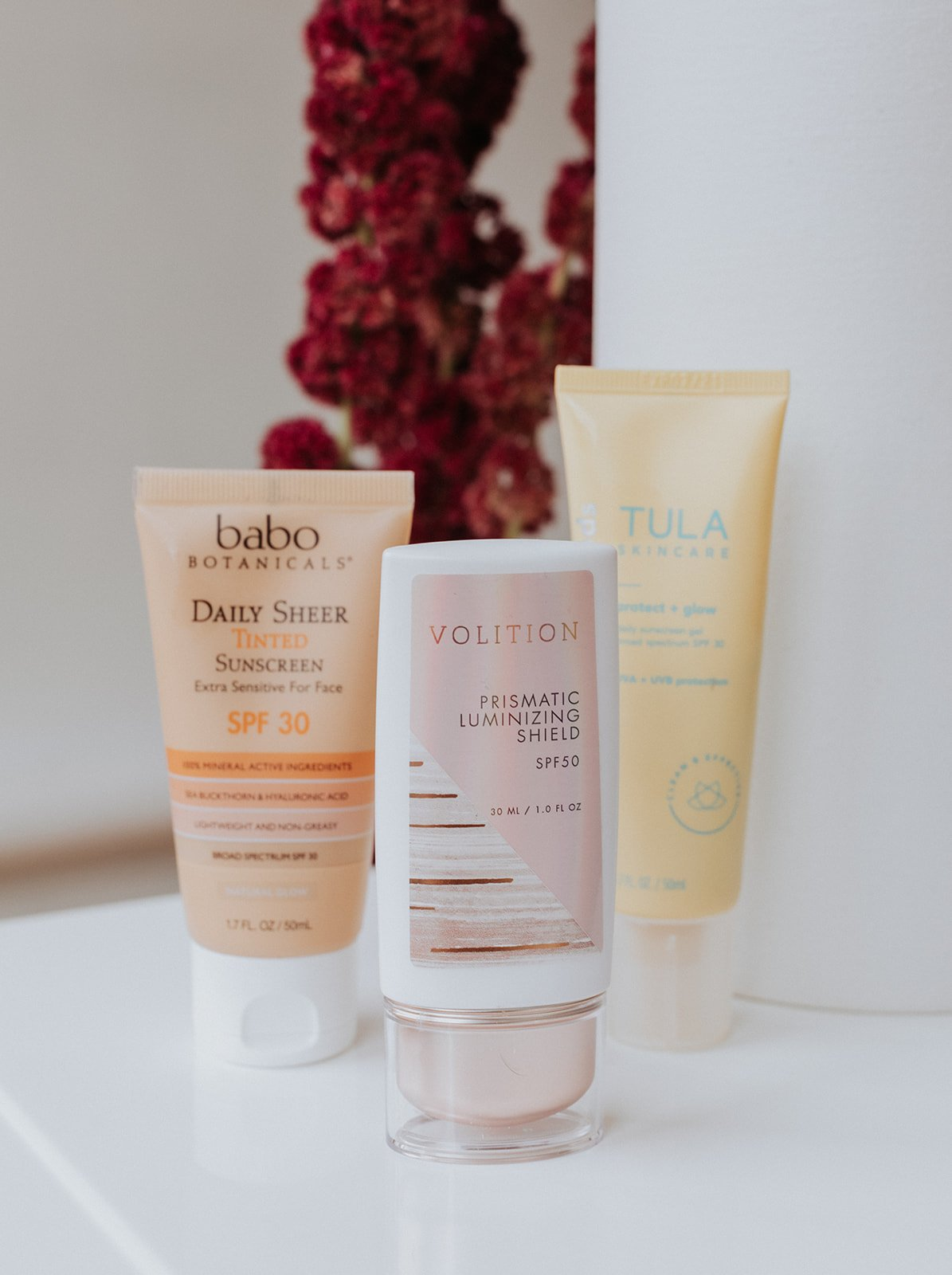 three bottles of all natural sunscreen