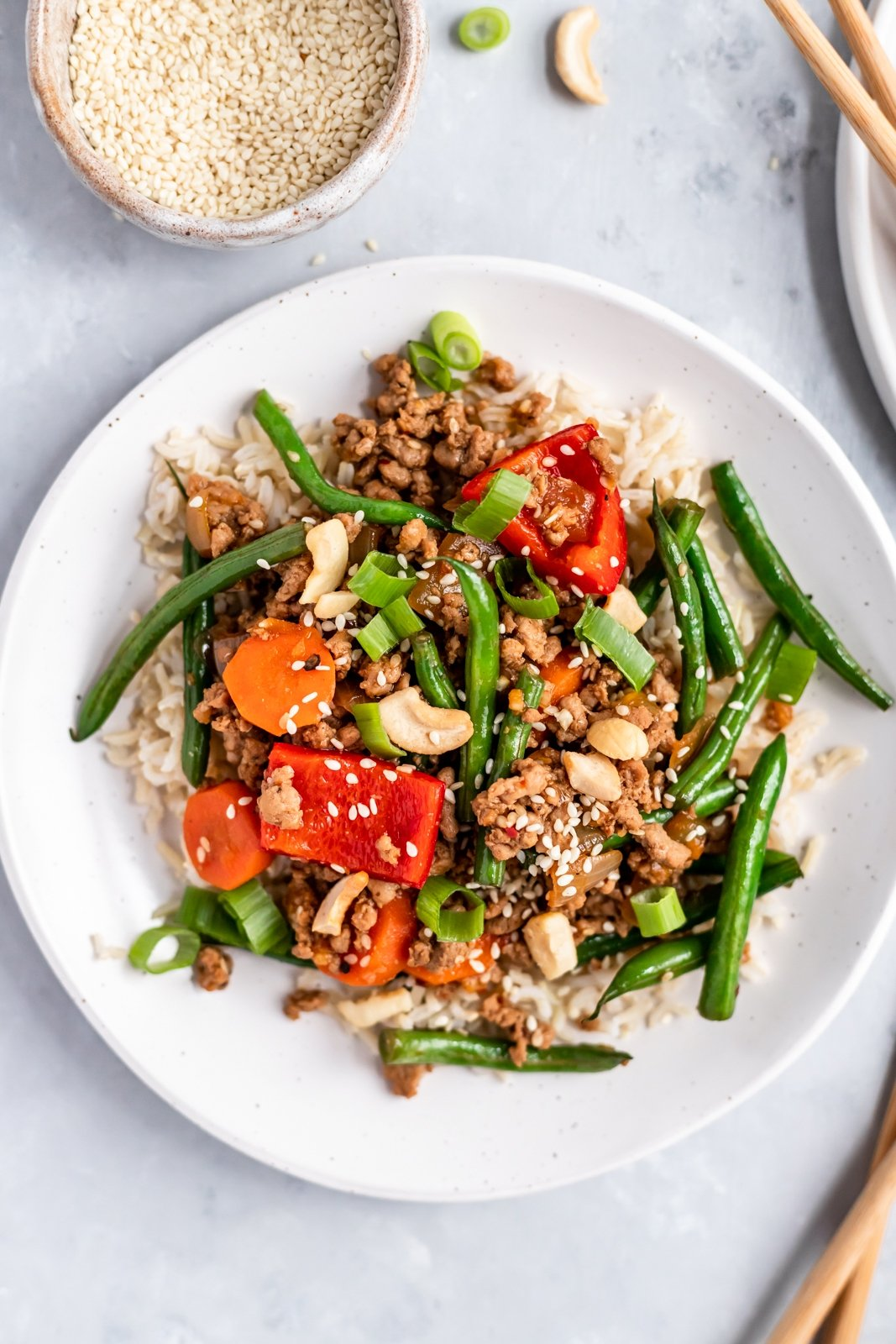 chicken and green beans stir fry on a plate