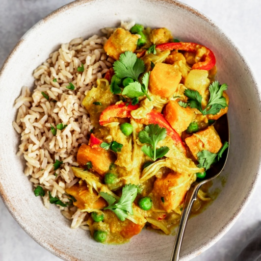 slow cooker yellow chicken curry in a bowl
