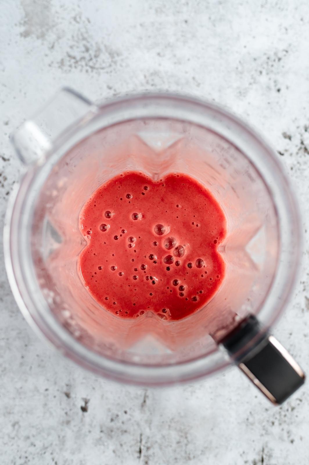 orange strawberry banana smoothie in a blender