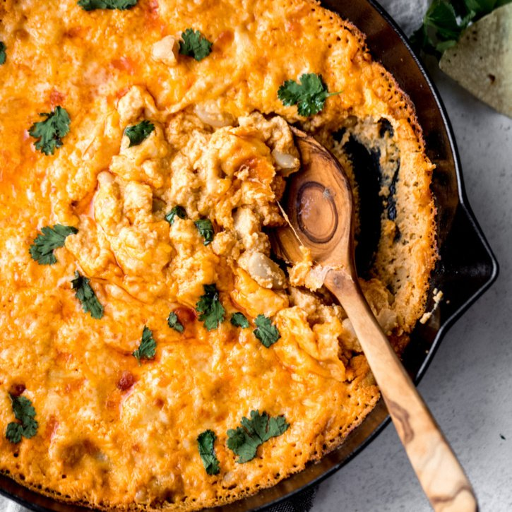 white bean buffalo dip in a skillet with a spoon