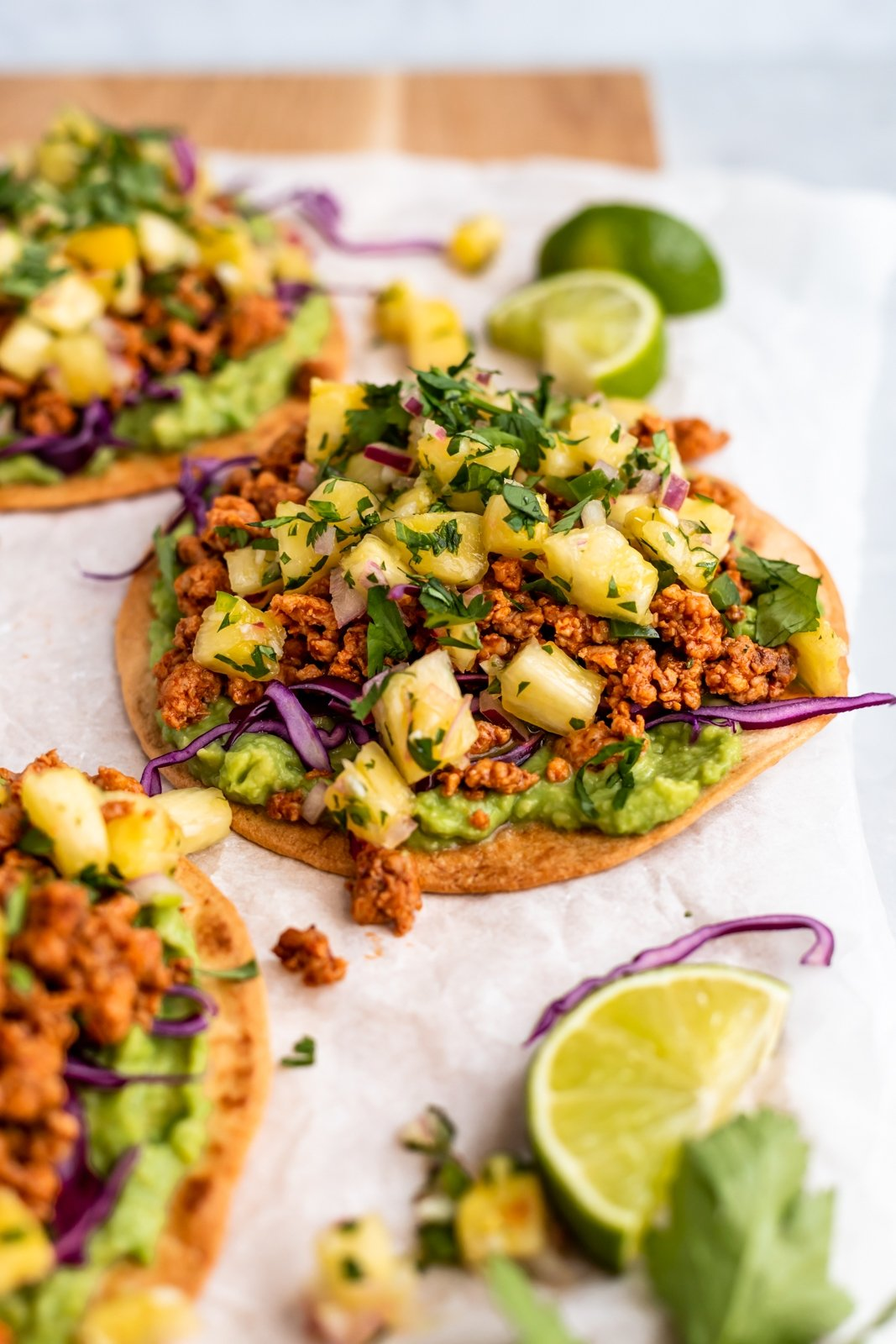 chipotle chicken tostada topped with pineapple salsa