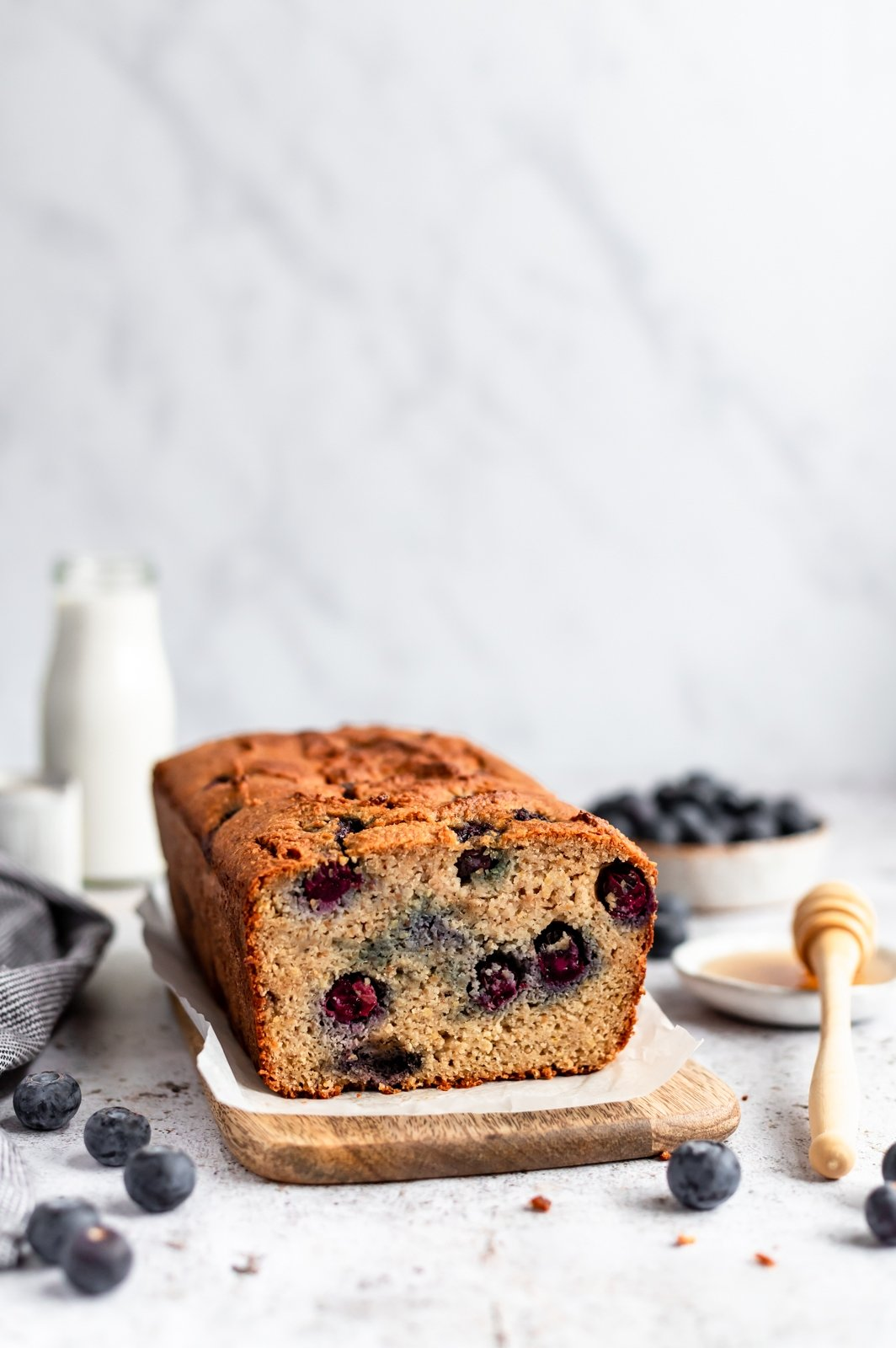 paleo almond flour blueberry bread with a slice cut out