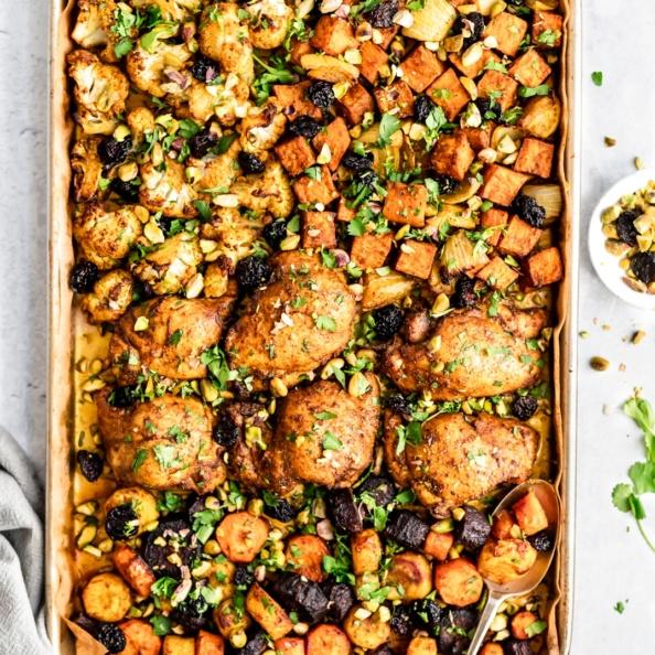 sheet pan Moroccan chicken and veggies on a pan
