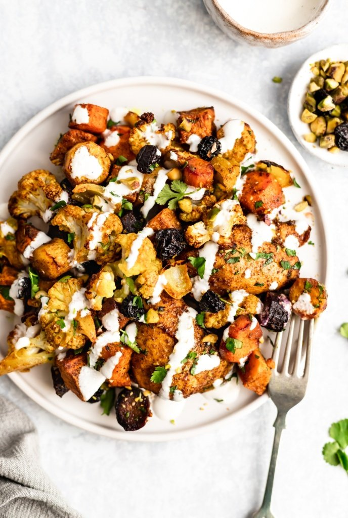 sheet pan moroccan chicken and veggies on a plate