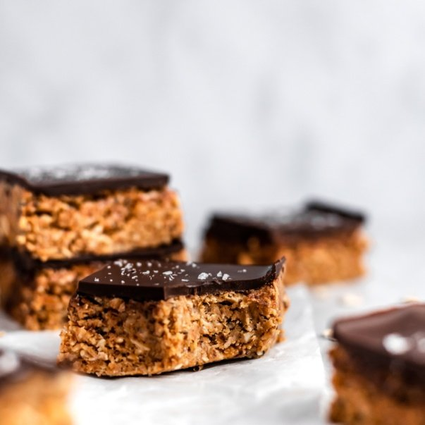 no bake chocolate peanut butter oatmeal bar with a bite taken out