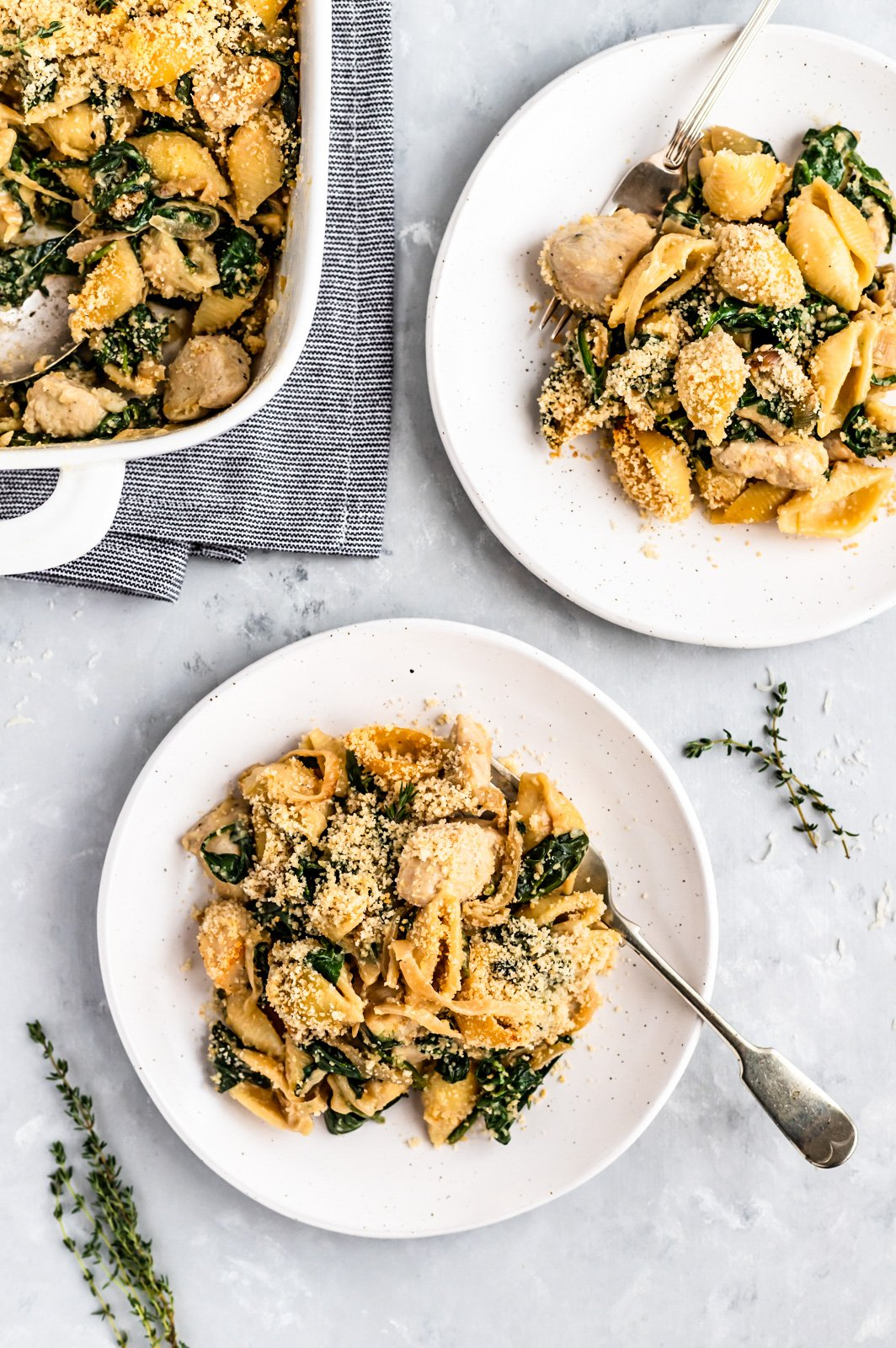 healthy spinach chicken pasta bake on two plates