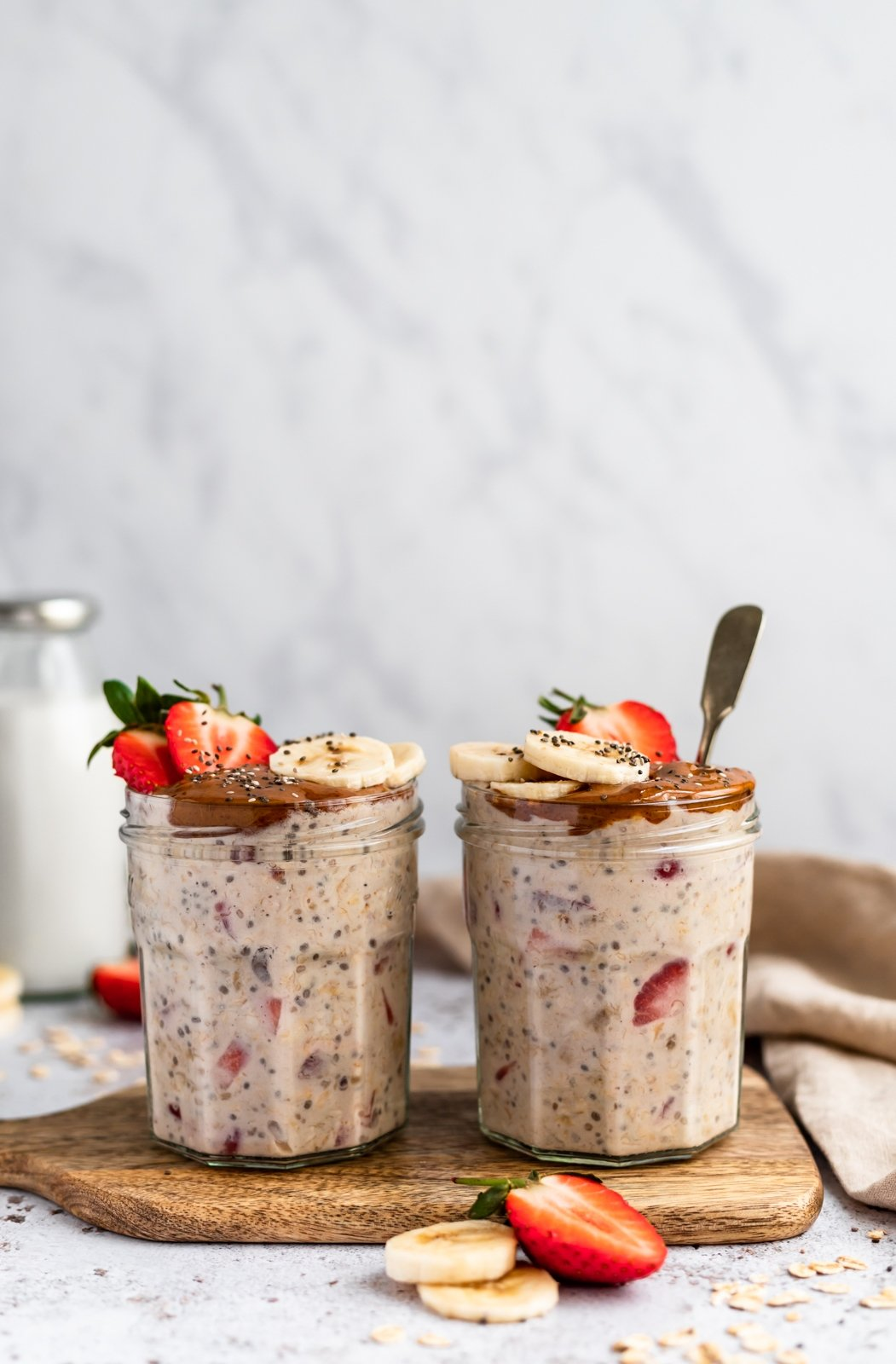 almond butter, strawberry and banana overnight oats in two jars