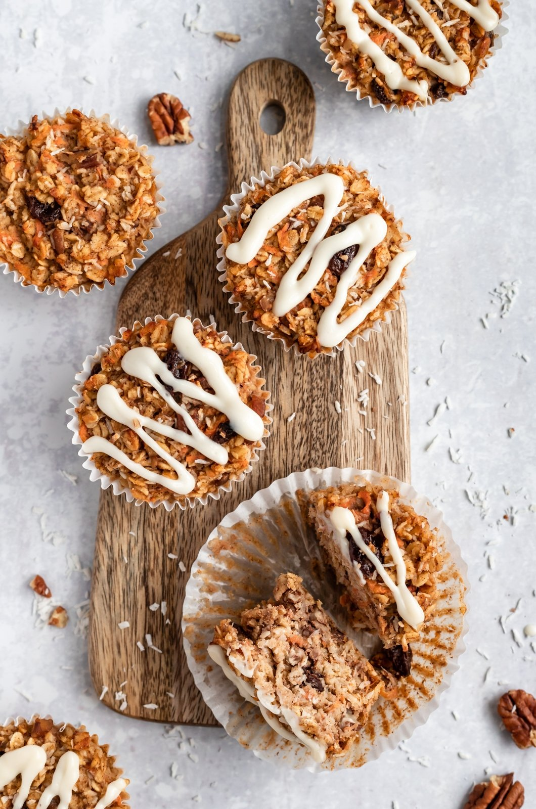 easy carrot cake baked oatmeal cups on a wooden tray