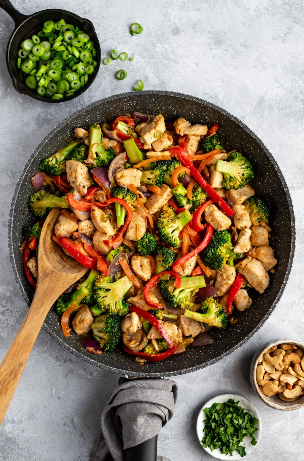 cashew chicken stir fry recipe in a wok pan
