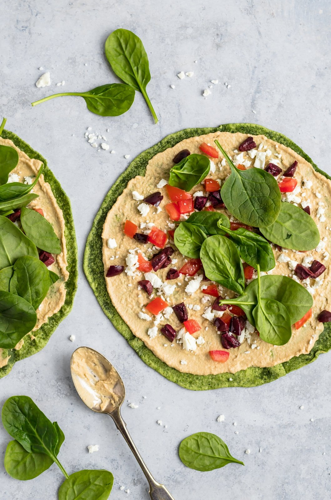 tortillas with toppings for greek pinwheels