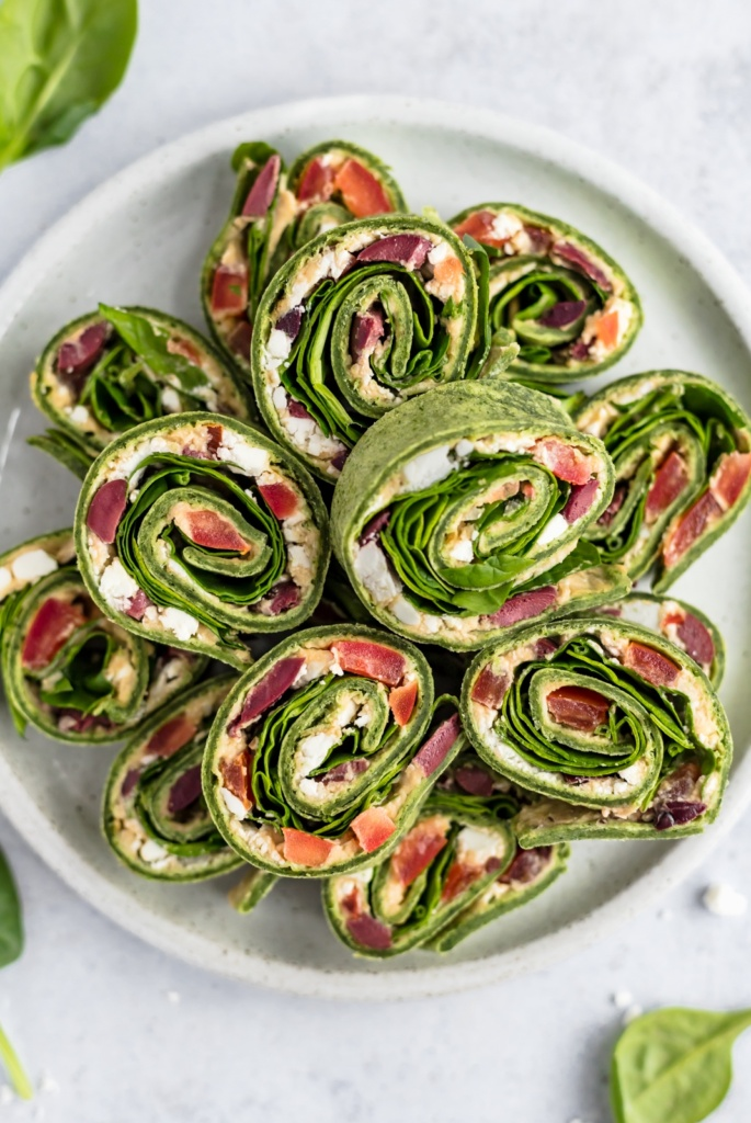 greek salad pinwheels on a platter