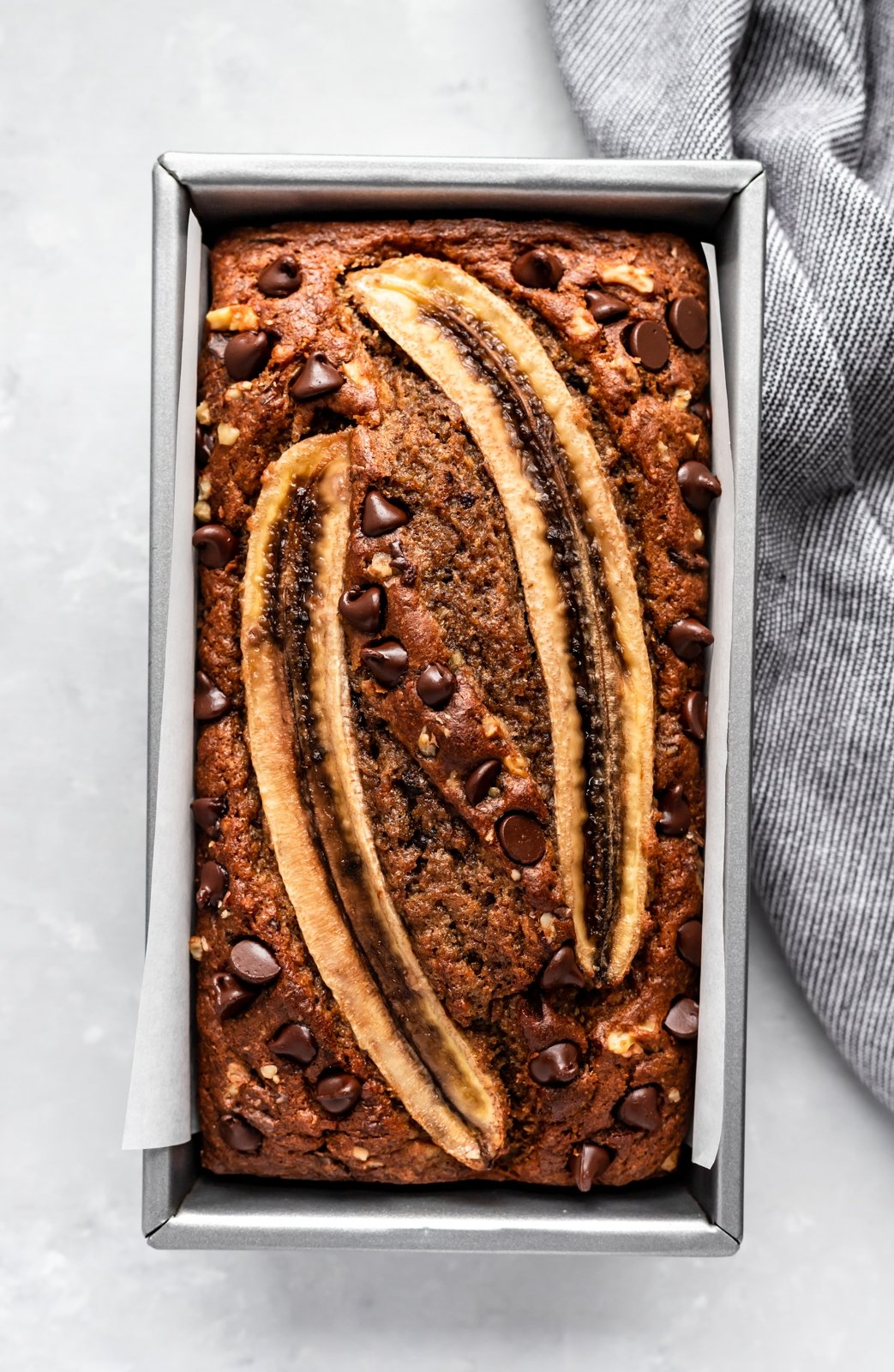healthy banana bread in a loaf pan