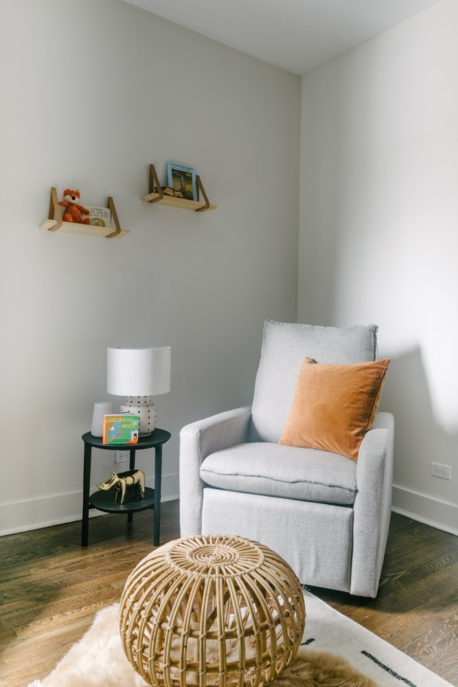 grey chair and wicker ottoman in a nursery