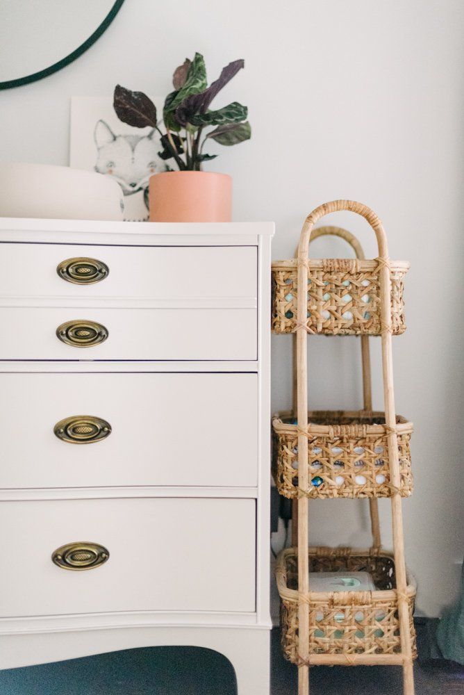 white dresser next to wicker baskets