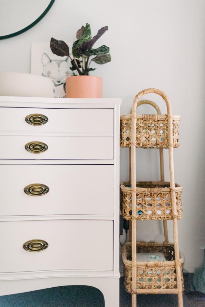 white dresser next to wicker baskets