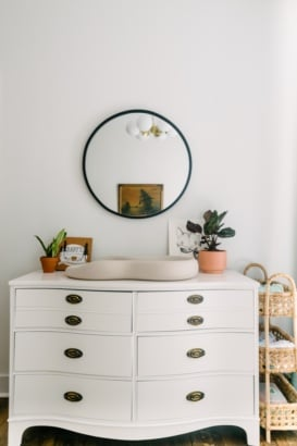 nursery dresser with mirror hanging on wall