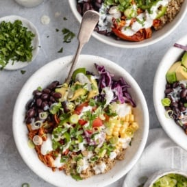 bbq chicken quinoa bowl with avocado, black beans, corn and cabbage