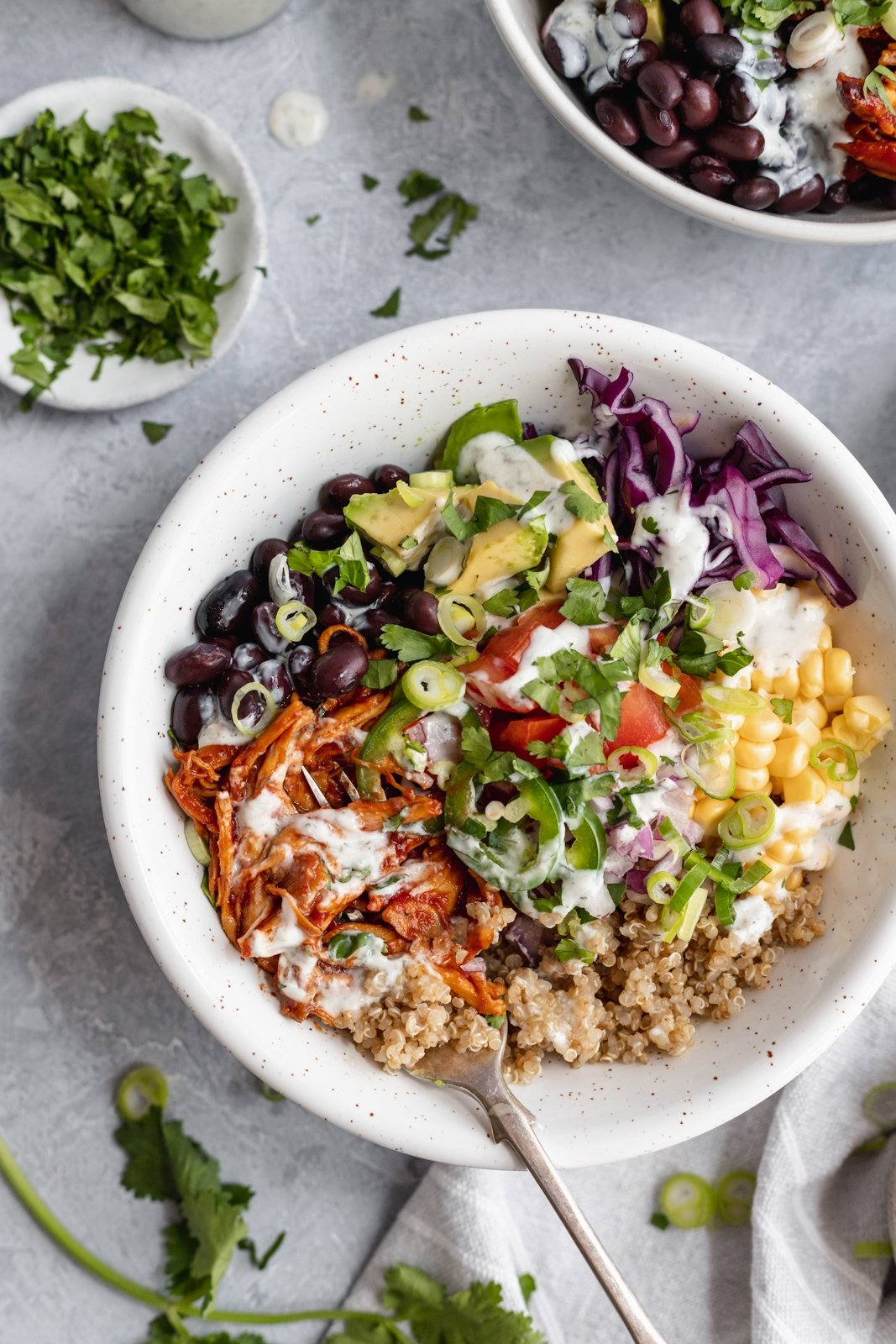 bbq ranch chicken quinoa bowl with corn, avocado and cabbage