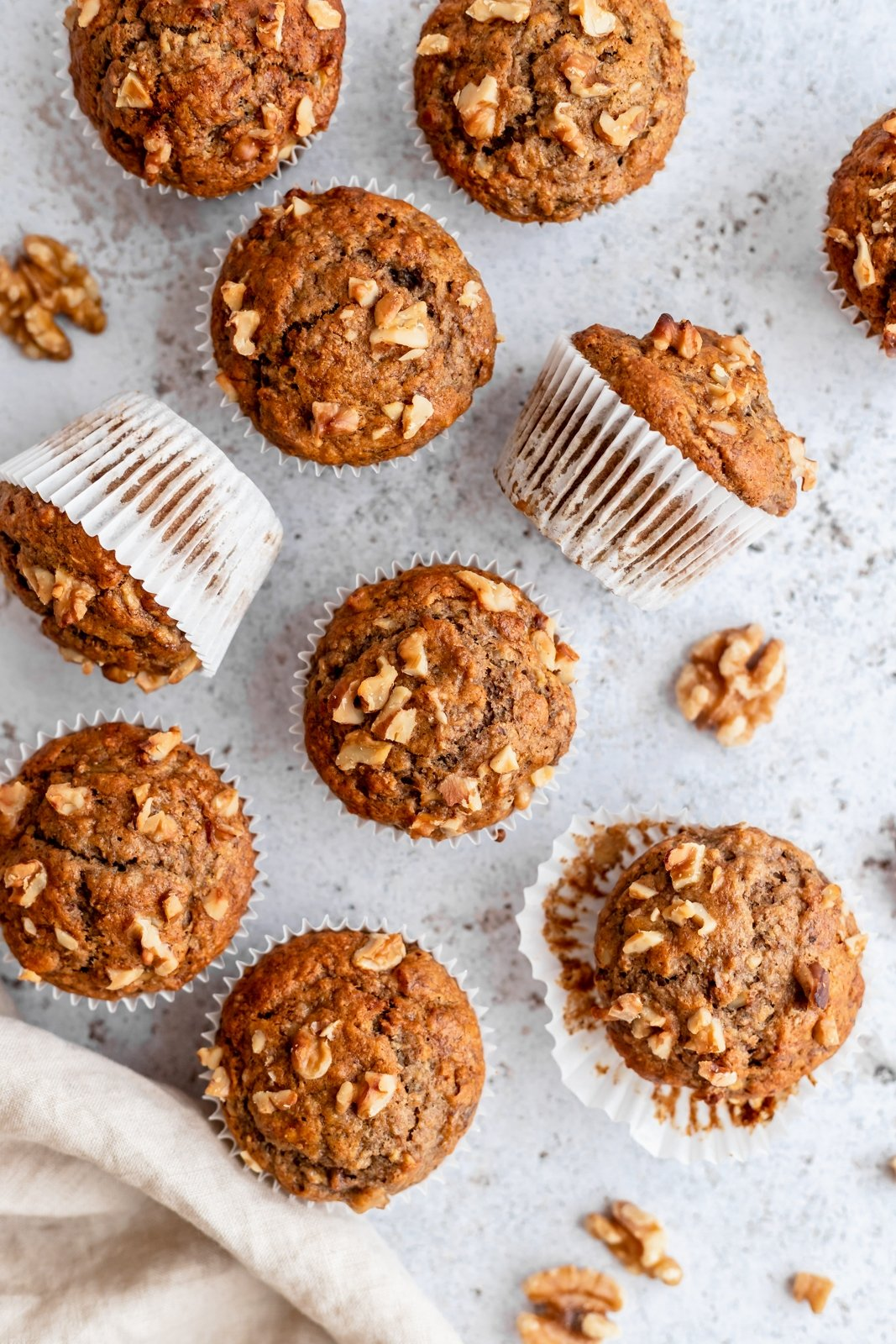 healthy banana muffins on a board with walnuts